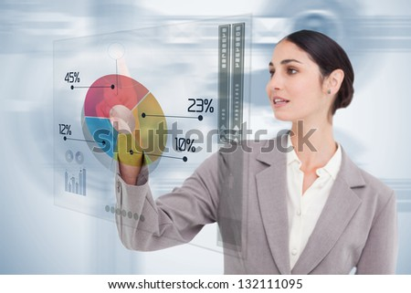 Businesswoman using colorful futuristic interface with her finger - stock photo
