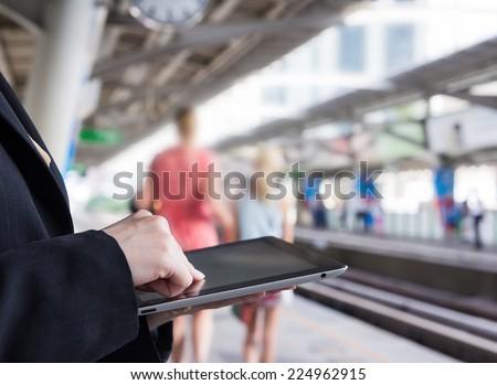 Businesswoman using digital tablet - stock photo