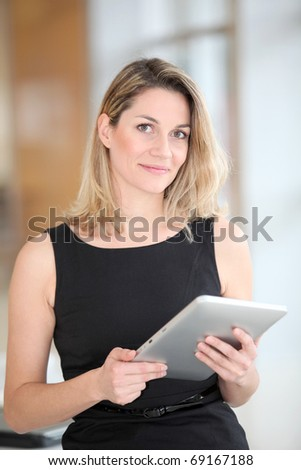 Businesswoman using electronic tab - stock photo