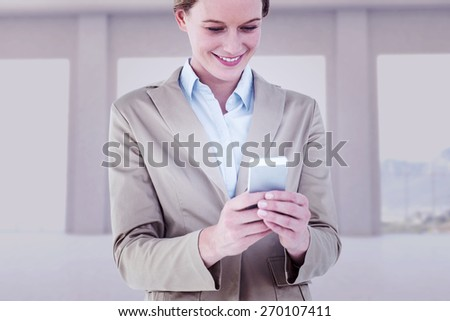 Businesswoman using her mobile phone against room overlooking ocean - stock photo