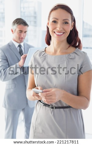 Businesswoman using her mobile phone in the office