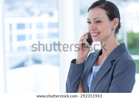 businesswoman using her phone at the office - stock photo