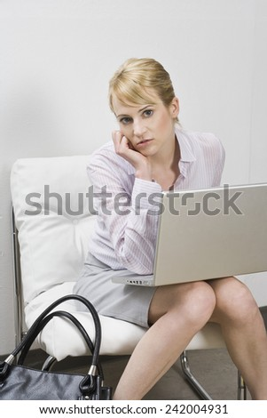 Businesswoman Using Laptop - stock photo