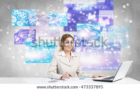 Businesswoman using media technologies