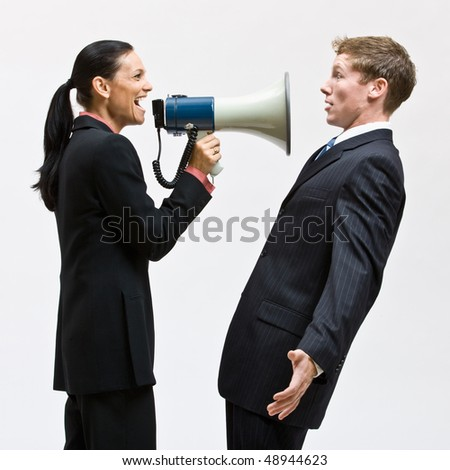 Businesswoman using megaphone - stock photo