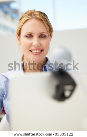 Businesswoman using online phone call and video - stock photo