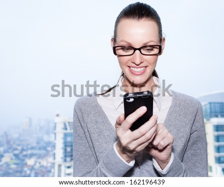 Businesswoman using smart mobile phone - stock photo