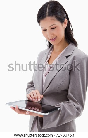 Businesswoman using tablet against a white background - stock photo