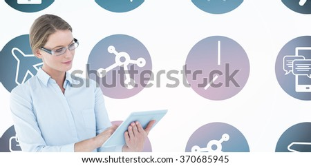 Businesswoman using tablet pc against telephone apps icons - stock photo