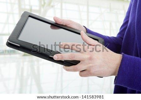 businesswoman using touch pad, close up shot on tablet pc, at the office - stock photo