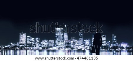 Businesswoman viewing night glowing city