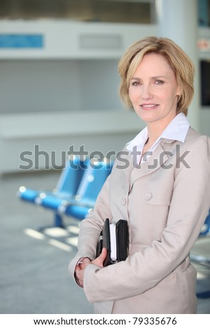 Businesswoman waiting at airport - stock photo