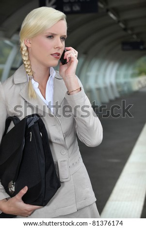 Businesswoman waiting for a train - stock photo