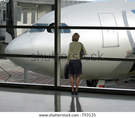 Businesswoman waits for her flight to board - stock photo