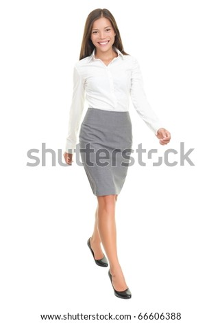 Businesswoman walking in full length on white background. Young smiling Asian / Caucasian female business woman smiling. - stock photo