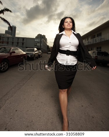 Businesswoman walking in the streets