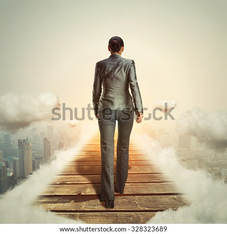 Businesswoman walking on her way to the light