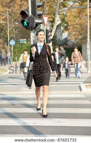 businesswoman walking on street, business in the city - stock photo