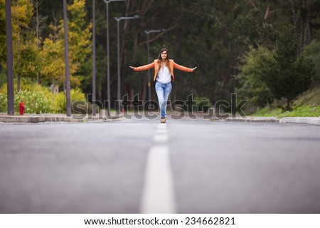 Businesswoman walking on the road - stock photo