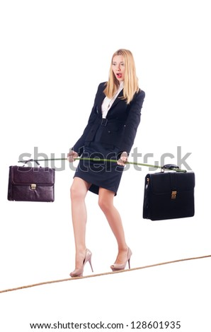 Businesswoman walking on tight rope isolated - stock photo
