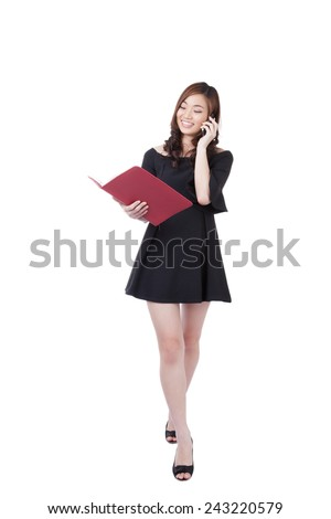 Businesswoman walking talking on mobile phone and hold daily. Young stylish business woman smiling isolated on white in full body. Mixed-race Chinese Asian / white Caucasian brunette female model. - stock photo