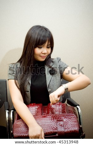 businesswoman waste her precious time waiting for an appointment. time is money concept - stock photo