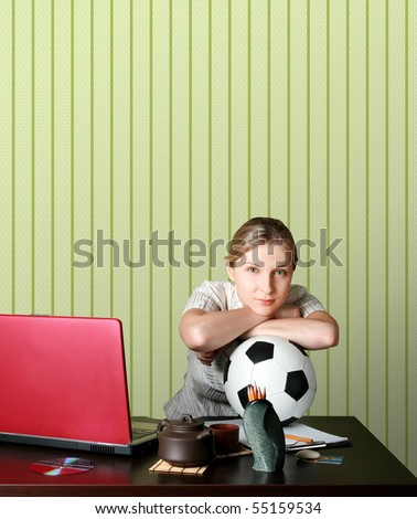 businesswoman watching soccer competitions with ball - stock photo