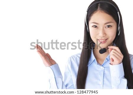 Businesswoman wearing a headset - stock photo