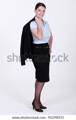 Businesswoman wearing a skirt suit - stock photo
