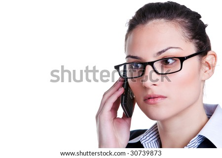 Businesswoman wearing glasses on a mobile phone - stock photo