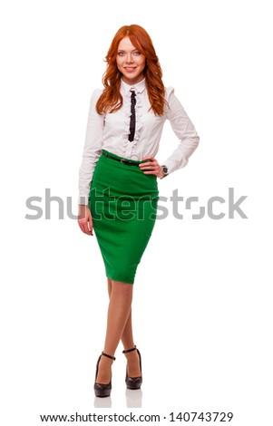 businesswoman wearing green skirt , full length isolated over white - stock photo
