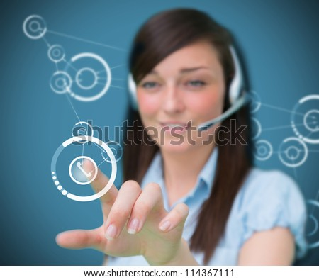 Businesswoman wearing headphones touching a symbol