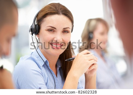 Businesswoman wearing headset - stock photo