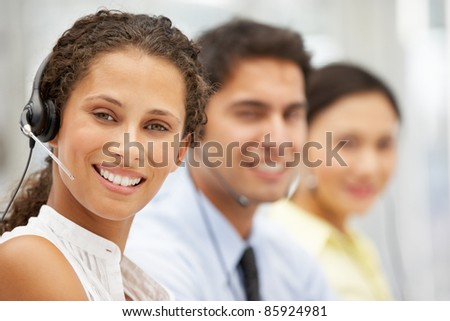 Businesswoman wearing headset - stock photo