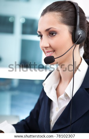 businesswoman wearing headset in office, close up - stock photo