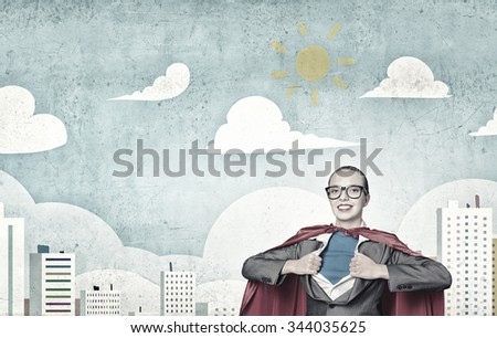 Businesswoman wearing red cape and opening her shirt like superhero - stock photo