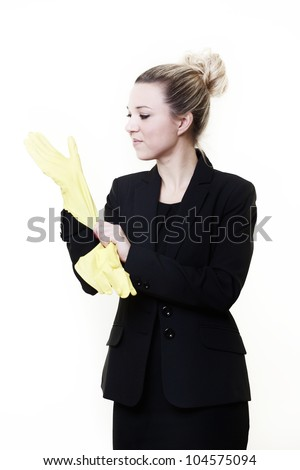 businesswoman wearing rubber gloves getting ready to do some cleaning up at work