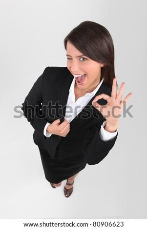 Businesswoman winking - stock photo