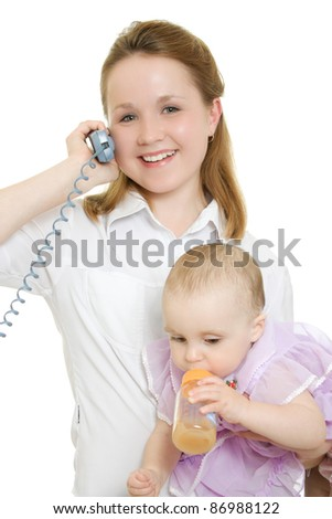 Businesswoman with a baby in her arms on the phone. - stock photo
