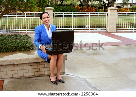 Businesswoman with a briefcase smiling at camera