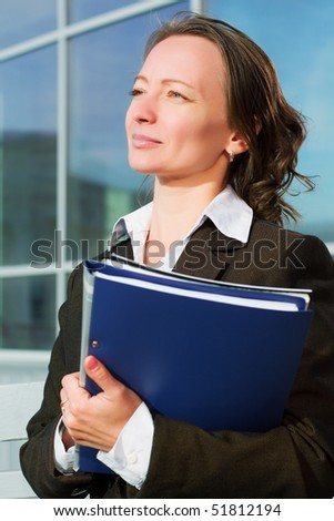 Businesswoman with a folders. - stock photo