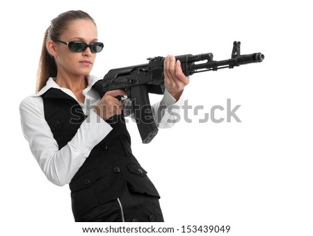 businesswoman with a gun isolated on white