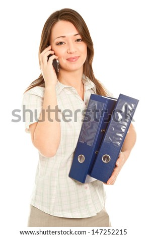 Businesswoman with a lot of folders with cellphone isolated on white - stock photo