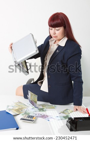 businesswoman with a lot of money - stock photo