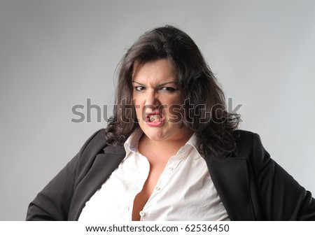 Businesswoman with angry expression - stock photo
