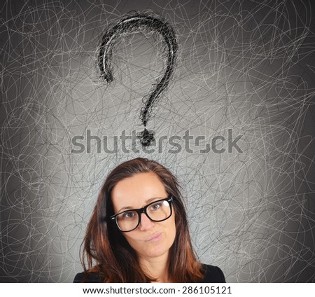 Businesswoman with big question mark over head - stock photo