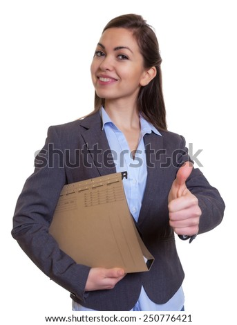 Businesswoman with brown hair and file showing thumb up - stock photo