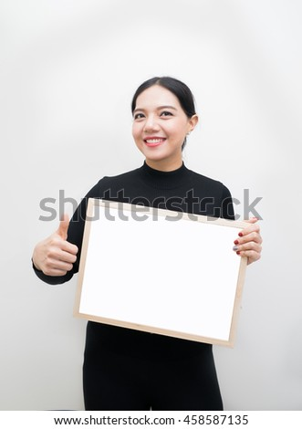 businesswoman with Bulletin Board ,Pretty young excited woman holding empty blank board,asian woman - stock photo
