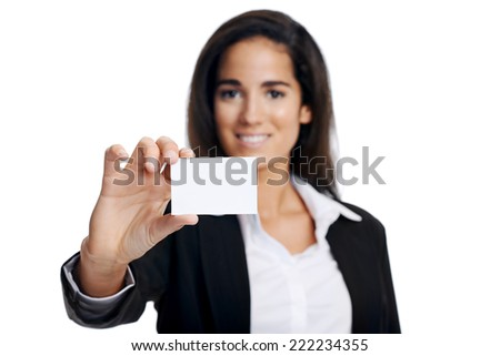 Businesswoman with business card showing towards camera with copyspace - stock photo