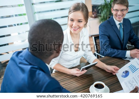 Businesswoman with business partner in office - stock photo